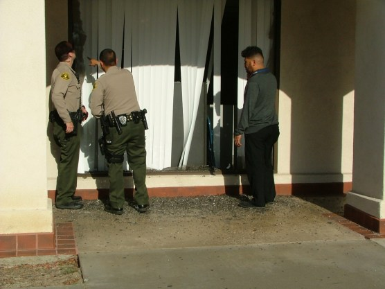 SCV Sheriff's Station deputies check out the broken window at the Valencia Post Office in Creekside Sunday afternoon. | Photo: Kevin Gilly/two8nine media.