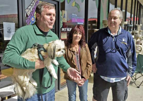 California State Senator Scott Wilk, left, holds his rescue dog, Simi as Wilk presents a Certificate of Recognition of Small Business of the Month to the owners Kathi Toaso, and Chris Hoeflich at Pet Supply in Saugus on Saturday. | Photo: Dan Watson/The Signal.