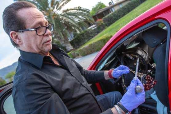 Cary Quashen examines needles found in Norwood's vehicle.   Signal Photo: Austin Dave.