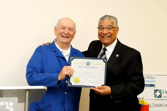 Santa Clarita City Councilman Bill Miranda (right) honors Jim Brush with a certificate of achievement.