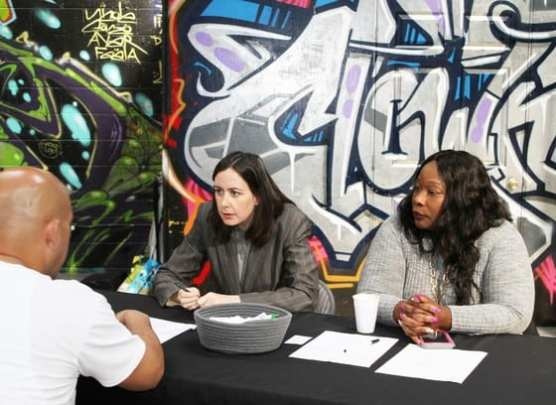 Deputy Public Defenders Ashley Price and Ericka Wiley provide post-conviction relief during a Prop 47 event at Chuco's Justice Center in Inglewood.