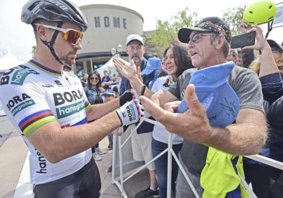 Current National Champion rider Peter Sagan, left, signs autographs and meets with fans before the start of the AMGEN Tour of California Men's Race in Valencia on Saturday. | Photo: Dan Watson/The Signal.
