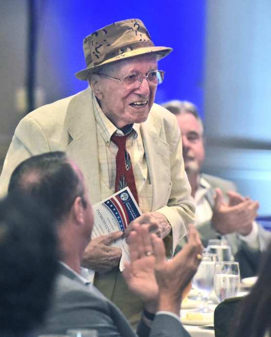 World War II veteran Mario Aquilani stands as he is honored during the 9th Annual Patriots Luncheon presented by The Santa Clarita Valley Chamber of Commerce and the City of Santa Clarita at the Hyatt Regency Valencia on Thursday. | Photo: Dan Watson/The Signal.