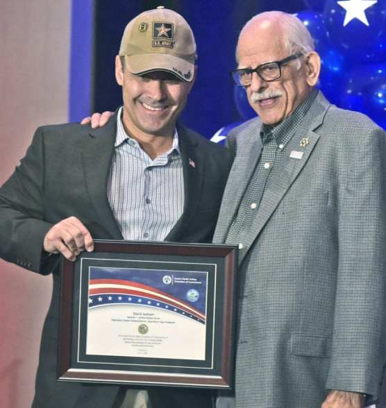 U.S. Army veteran David Jackson, left, is presented his plaque by Elliott Wolfe as Jackson is honored for his service during Operation Desert Shield/Storm and Operation Iraqi Freedom during the 9th Annual Patriots Luncheon presented by The Santa Clarita Valley Chamber of Commerce and the City of Santa Clarita at the Hyatt Regency Valencia on Thursday.  | Photo: Dan Watson/The Signal.
