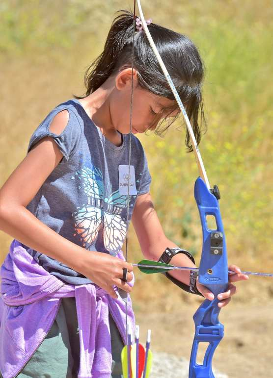 Emma Evaristo, 11, of Stevenson Ranch prepares to shoot during the 2019 Olympic Day held at the Santa Clarita Archery Range in Canyon Country on Saturday.   Photo: Dan Watson/The Signal.