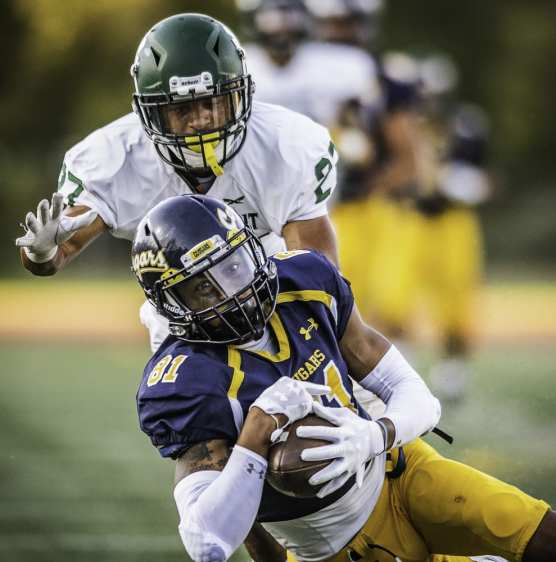 gallery - College of the Canyons' Romello Cook hauls in a 42-yard pass from Armani Edden as Grossmont College's Joel Mewis covers on the play. Canyons beat Grossmont 41-13 Saturday, September 14, 2019 at COC Stadium. | Photo: Kevin Karzin.