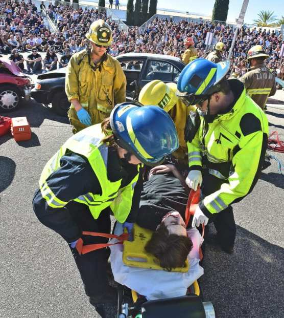 "Hundreds of Saugus High School juniors and seniors look on as first responders remove the ""dead body"" of Saugus High School junior, Rick Hand, representing the victim in a drunk driving, head-on collision during the ""Every 15 Minutes"" event held at Saugus High School on Thursday, November 7, 2019. 