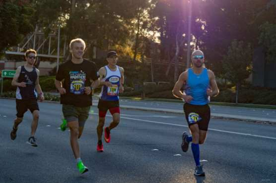 Runners competing in the Santa Clarita Marathon lead the pack as they make their way down the first leg of the race on Valencia Blvd. on Sunday, Nov. 3, 2019. | Photo: Gilbert Bernal/The Signal.