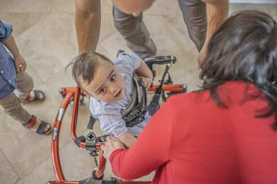 Mihaela and Sterling King help fit their son Abram into his specialized walker. They are planning a Feb. 1 benefit concert to raise funds for his cerebral palsy treatment. | Photo December 21, 2019, by Bobby Block / The Signal.