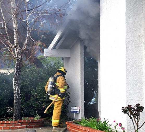 Firefighter Battles Housefire