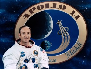 Apollo astronaut Edgar Mitchell in front of a graphic of the mission patch. Photo: NASA