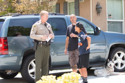 Santa Clarita Valley Sheriff's Station deputies tell residents on Southern Oaks Drive that mandatory evacuations are in effect.