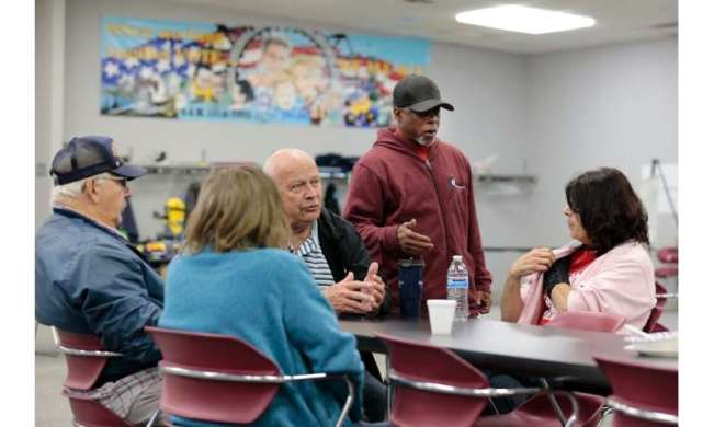 UAW Local 5960 members talk at their union hall on October 11 in Lake Orion, Michigan
