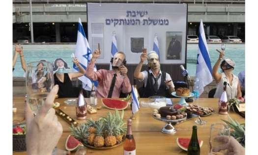 Israel imposes overnight curfews as virus deaths pass 1,000