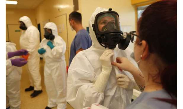 Short of medics as virus surges, central Europe sounds alarm