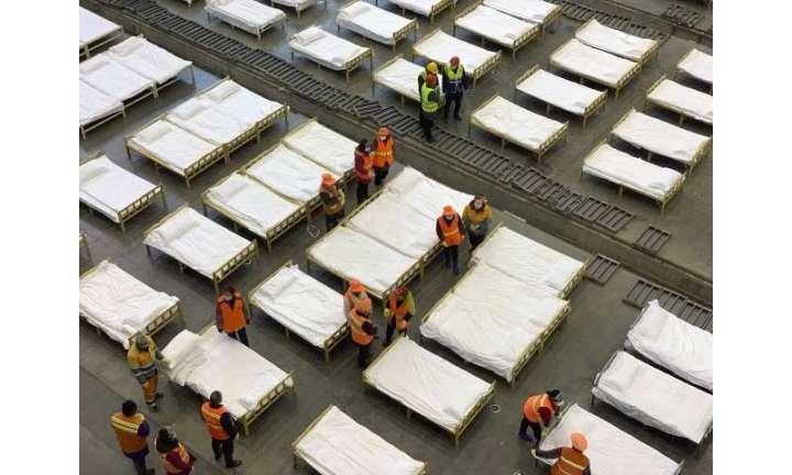 Hong Kong reports virus death as workers strike at hospitals