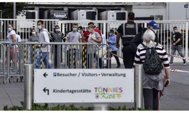 Britain lowers virus alert, Germany sees spike in cases