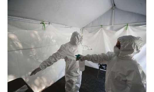 Mexico City closes bars, limits eateries as virus cases rise