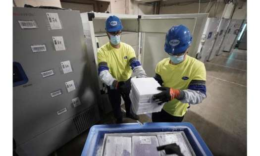 Boxes containing the Pfizer-BioNTech Covid-19 vaccine are prepared to be shipped at the Pfizer plant in Kalamazoo, Michigan