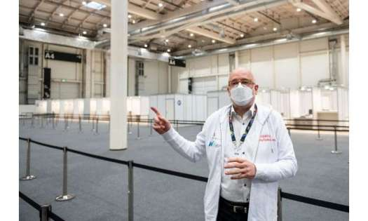 Dirk Heinrich, a senior physician at a vaccination centre in Hamburg, shows off the facilities
