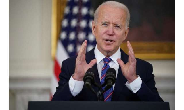 US President Joe Biden speaks about the March jobs report and Covid-19 in the State Dining Room of the White House