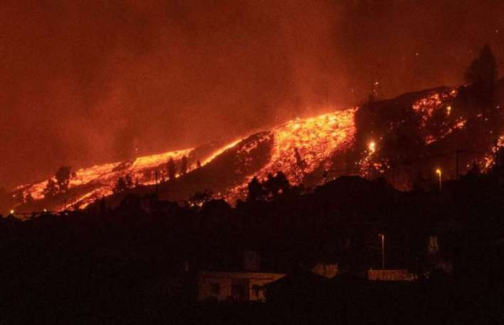 The lava from an eruption of the Cumbre Vieja volcano reached several homes and made a number of roads impassable