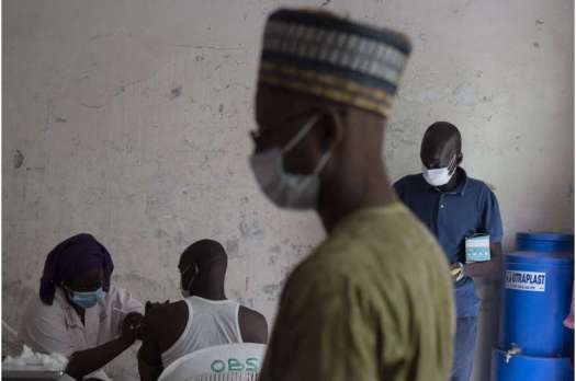 West African health officials race to vaccinate amid spikes