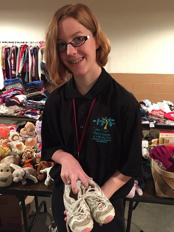 Olivia Lesko, 14, volunteers in the clothing distribution area. (Visitor)