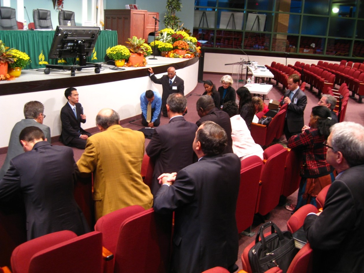 The prayer team leading a prayer time with church leaders at a previous Annual Council. (Melody Mason)