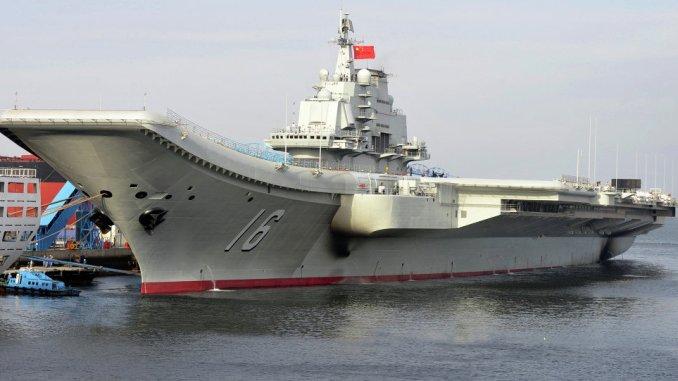 إدخال حاملة الطائرات الصينية إلى الخدمة في 25 أيلول/ سبتمبر 2012 ( وكالة الأنباء الصينية شينخوا)