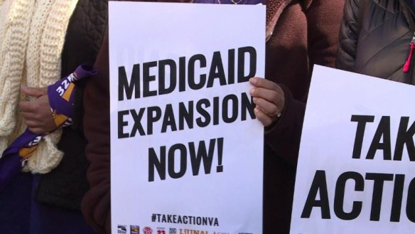 Image of protest sign: Medicaid Expansion Now