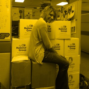 Yellow gradient map image of employee on boxes.