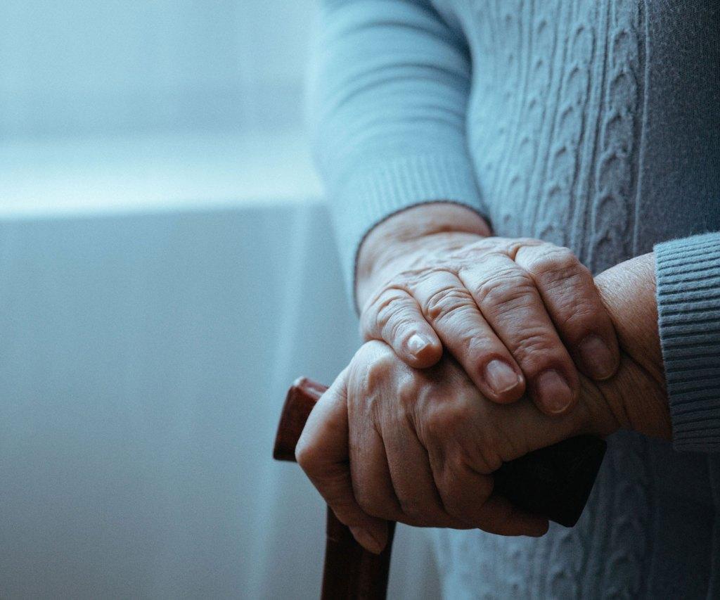 senior woman holding a cane