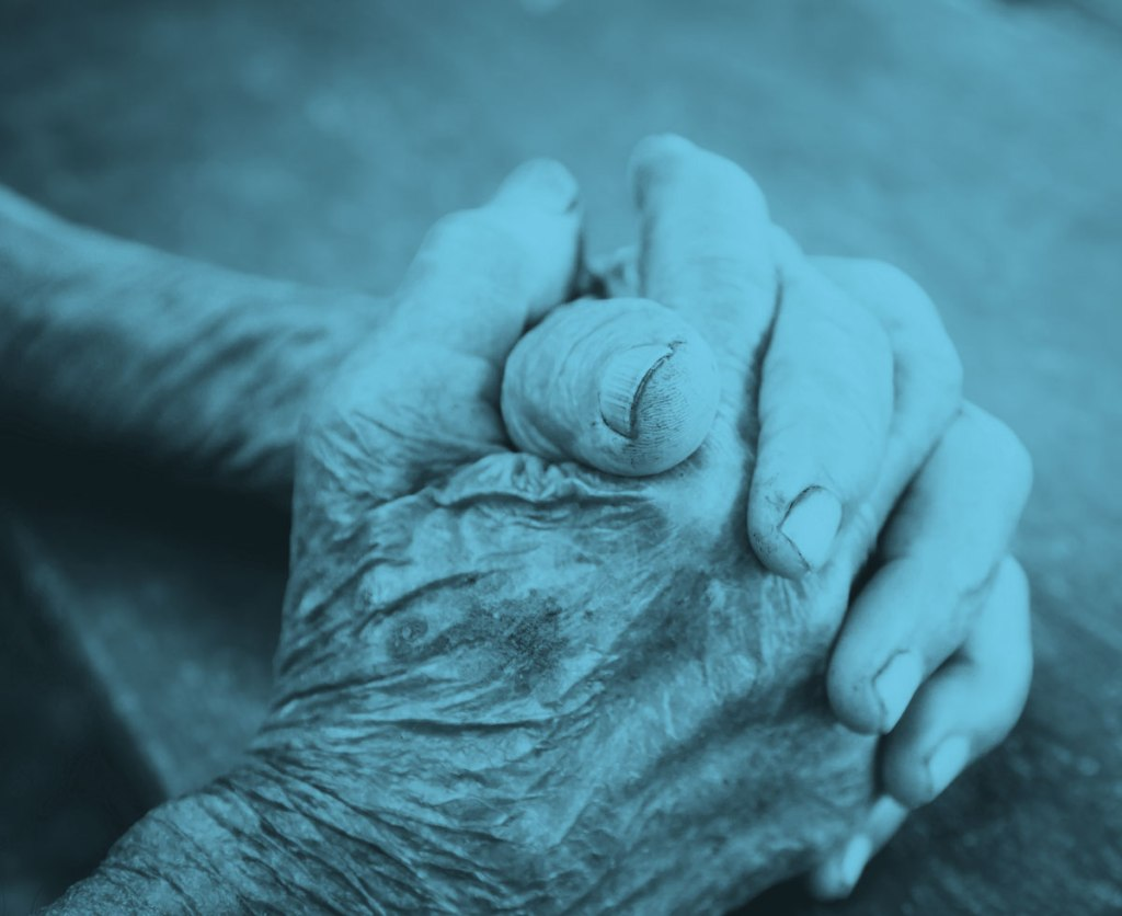 close up on an older woman's clasped hands