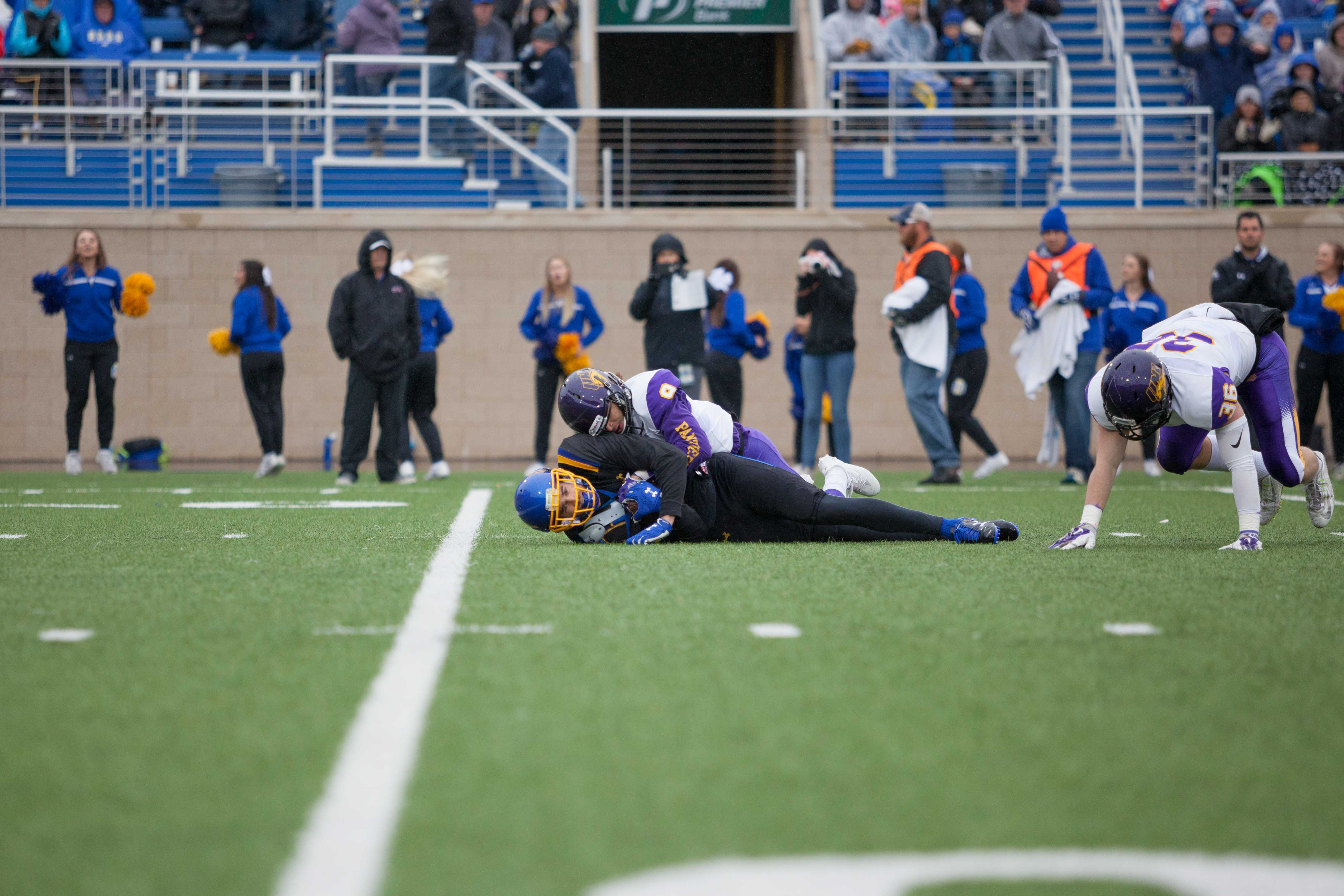 THIEN NGUYEN  Jake Wieneke is brought down after catching a 19-yard pass for a first down Oct. 14 during the Hobo Day game. The Jacks fell to the Panthers 38-18.
