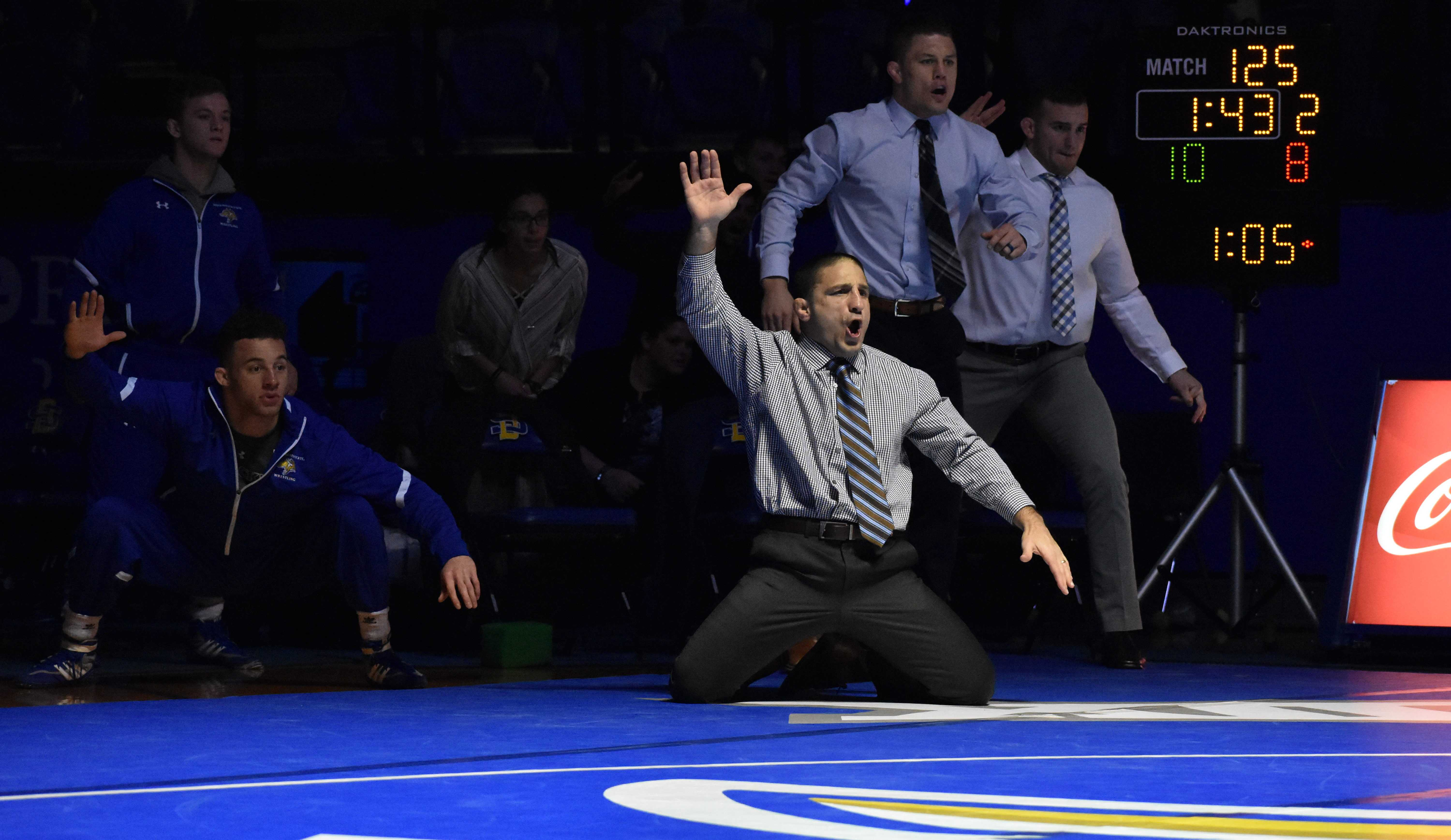 """ABBY FULLENKAMP """"He is always fired up, there is never a time where you don't get that,"""" junior Seth Gross said. Chris Bono became the head coach of the wrestling team in 2012, and SDSU has improved each season under his leadership."""