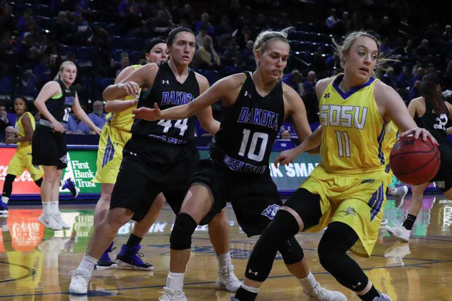 Junior+guard+Madison+Guebert+%2811%29+blocks+the+ball+from+Wesleyan+guard+Rylie+Osthus+%2810%29+during+the+game+Jan.+16.+The+Jacks+won+76-63.