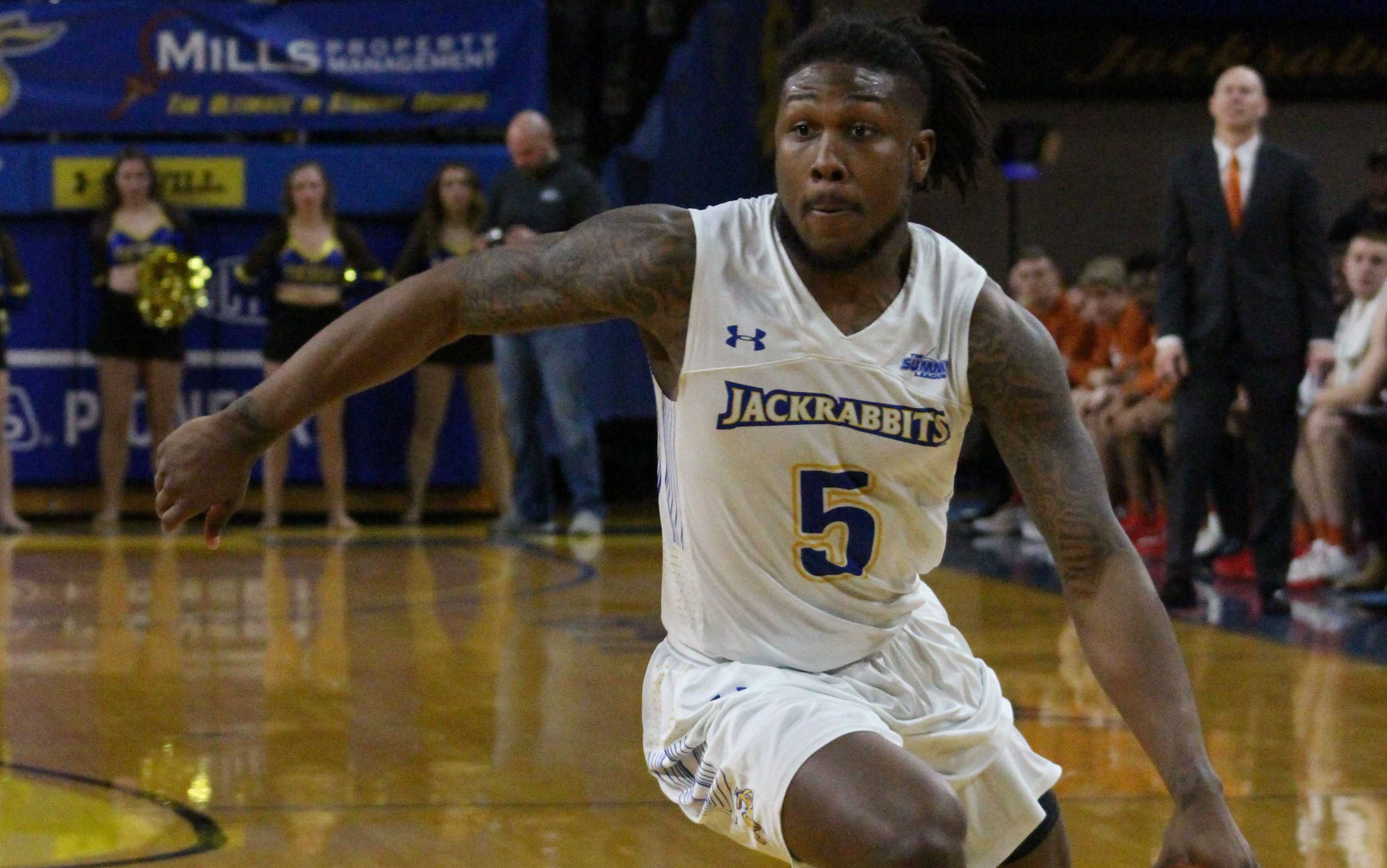 ABBY FULLENKAMP Freshman guard David Jenkins Jr. (5) blows past his defender in Thursday's game against USD. The Jacks have finished conference play and will begin Summit League tournament play against WIU at 6 p.m. March 3rd at the Denny Sanford Premier Center.