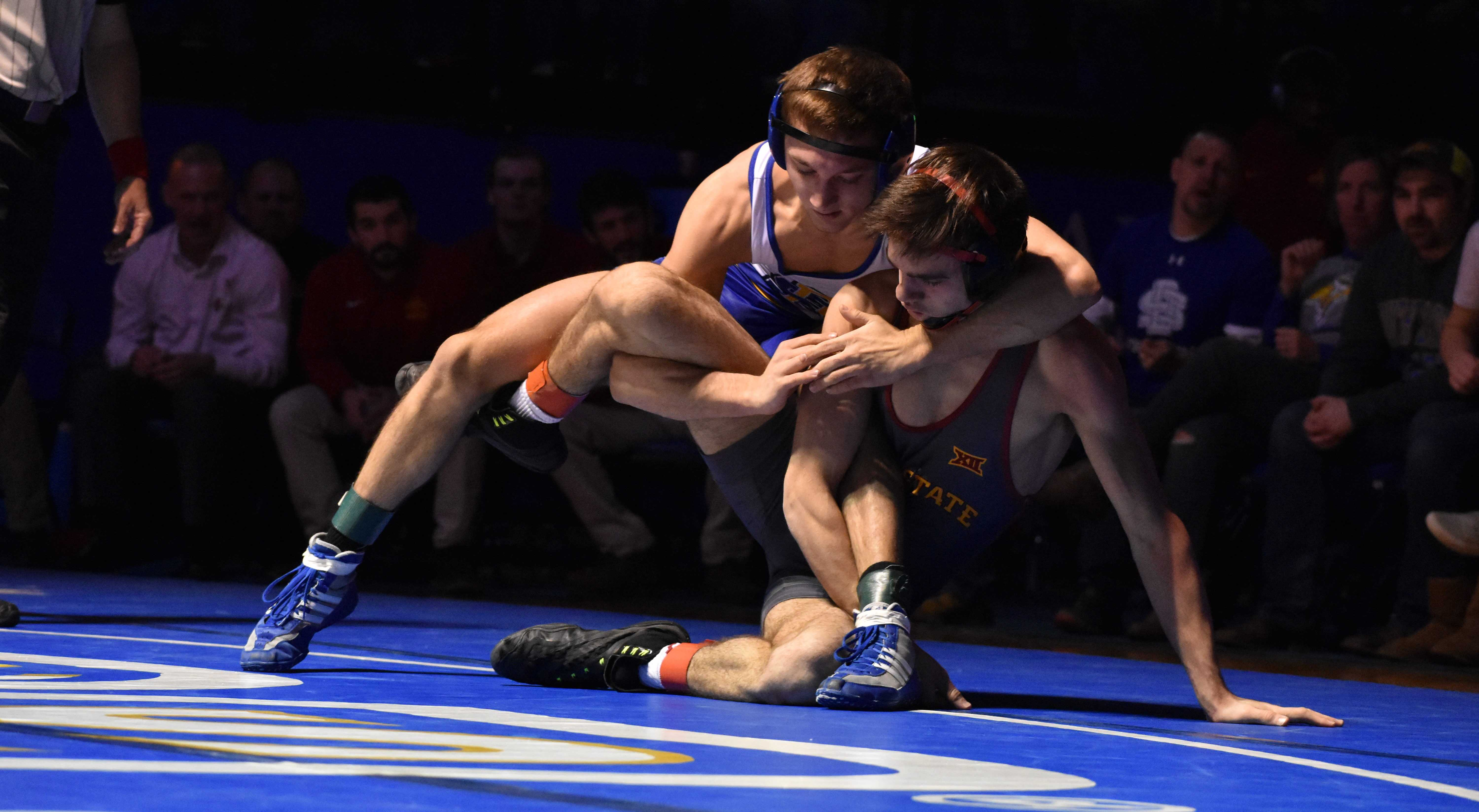 ABBY FULLENKAMP Freshman Connor Brown puts ISU Sinjin Briggs in a cradle during the 125-pound bout Feb. 4. Brown defeated Briggs by pin fall 2:07. The Jacks are 6-0 in the conference and are 11-2 overall. They host NDSU at 7pm Friday, Feb. 16 in Frost Arena.
