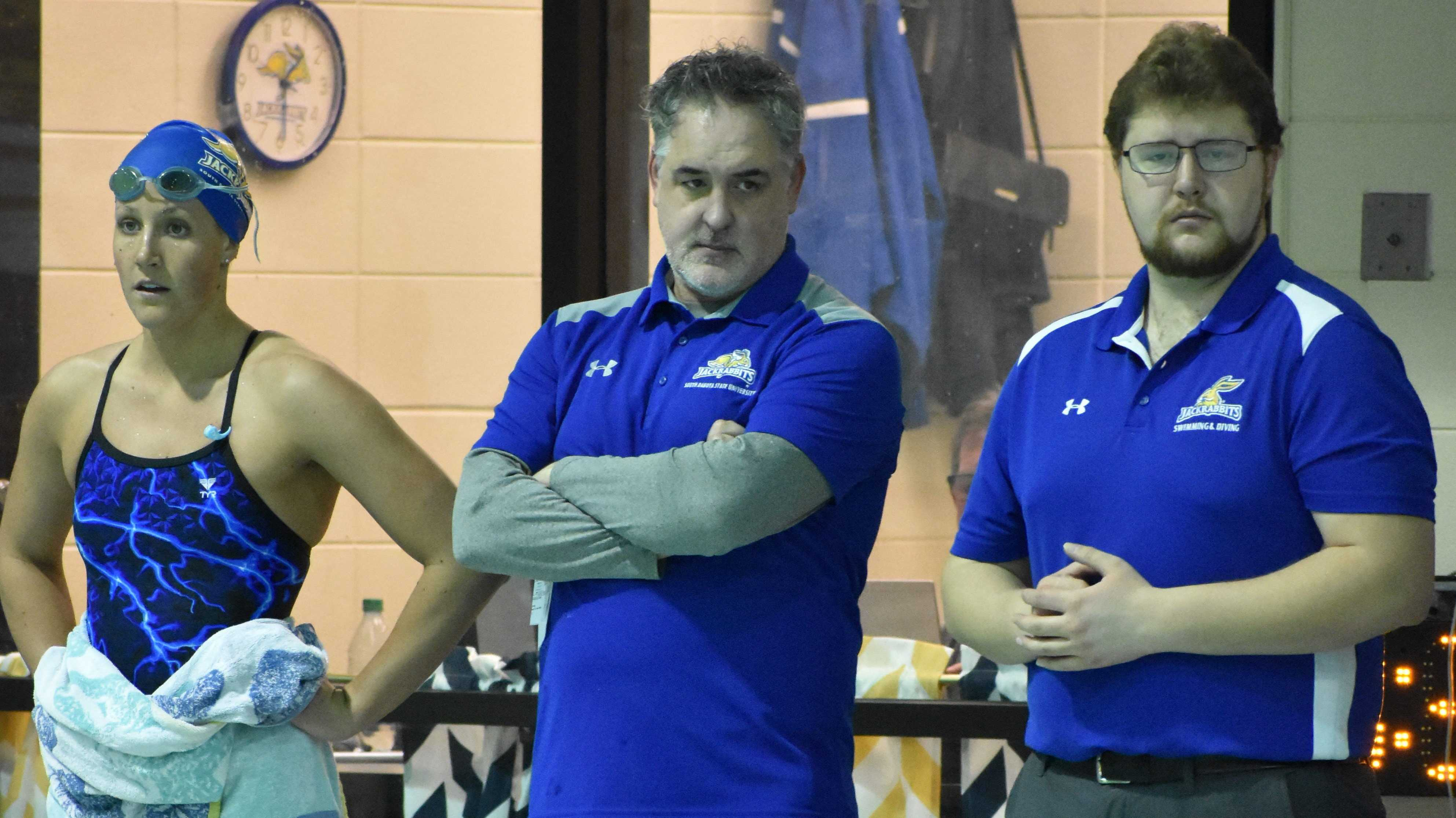 ABBY FULLENKAMP Head swim coach Doug Humphrey and assistant Kaden Huntrods watch the 1,000 yard freestyle during the women's swim meet against UNI Friday, Jan. 26. The women's team is 5-1 overall and the men's team is 3-1 overall.