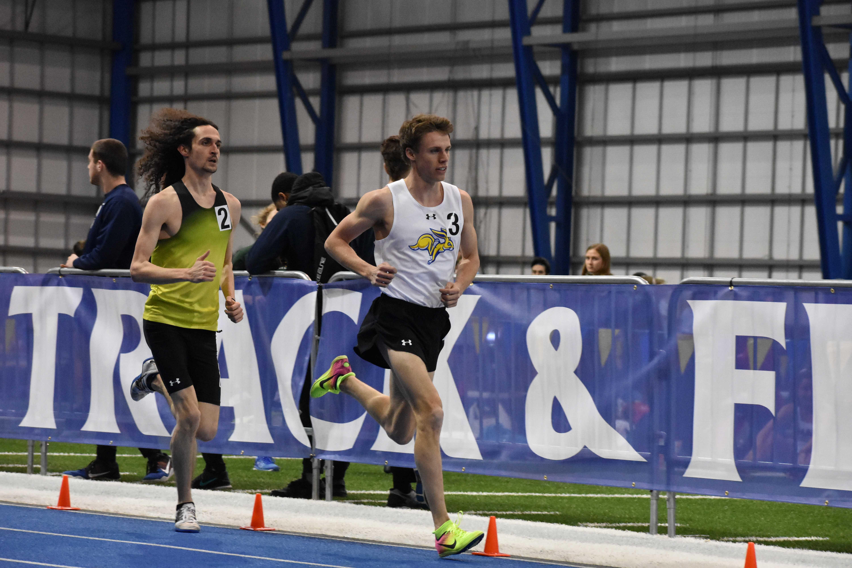 ABBY FULLENKAMP Junior Kyle Burdick runs in the men's 3,000 meter run during the SDSU Indoor Classic last year.