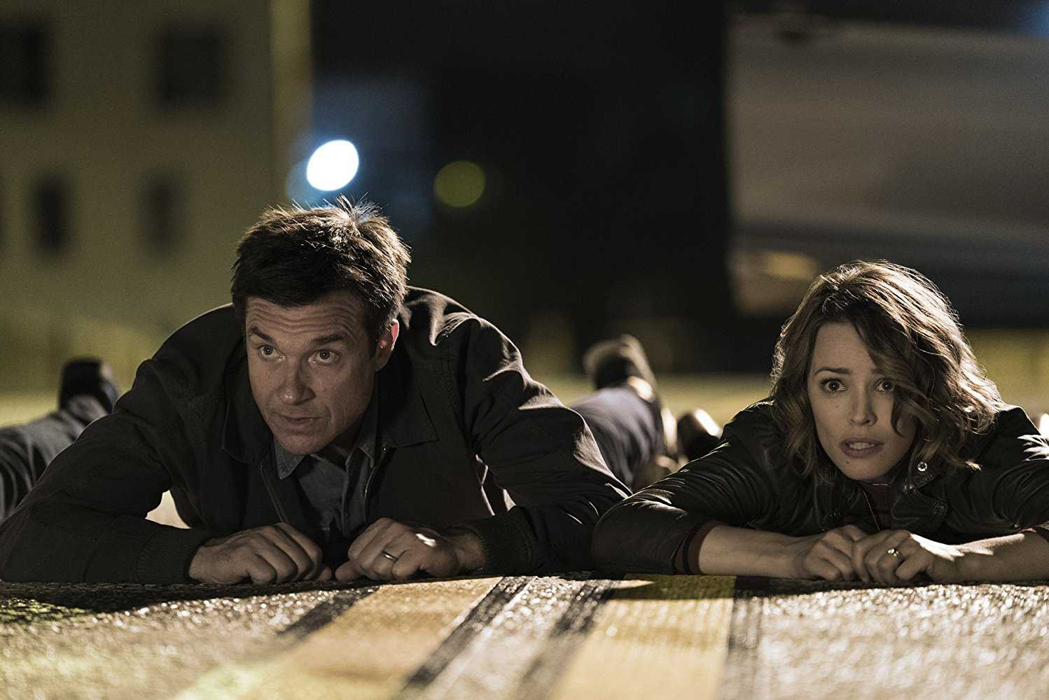"WARNER BROS. Jason Bateman and Rachel McAdams star as aspriring parents in ""Game Night."" The film opened with a $17 million over the weekend, putting it at the number two spot after ""Black Panther."""