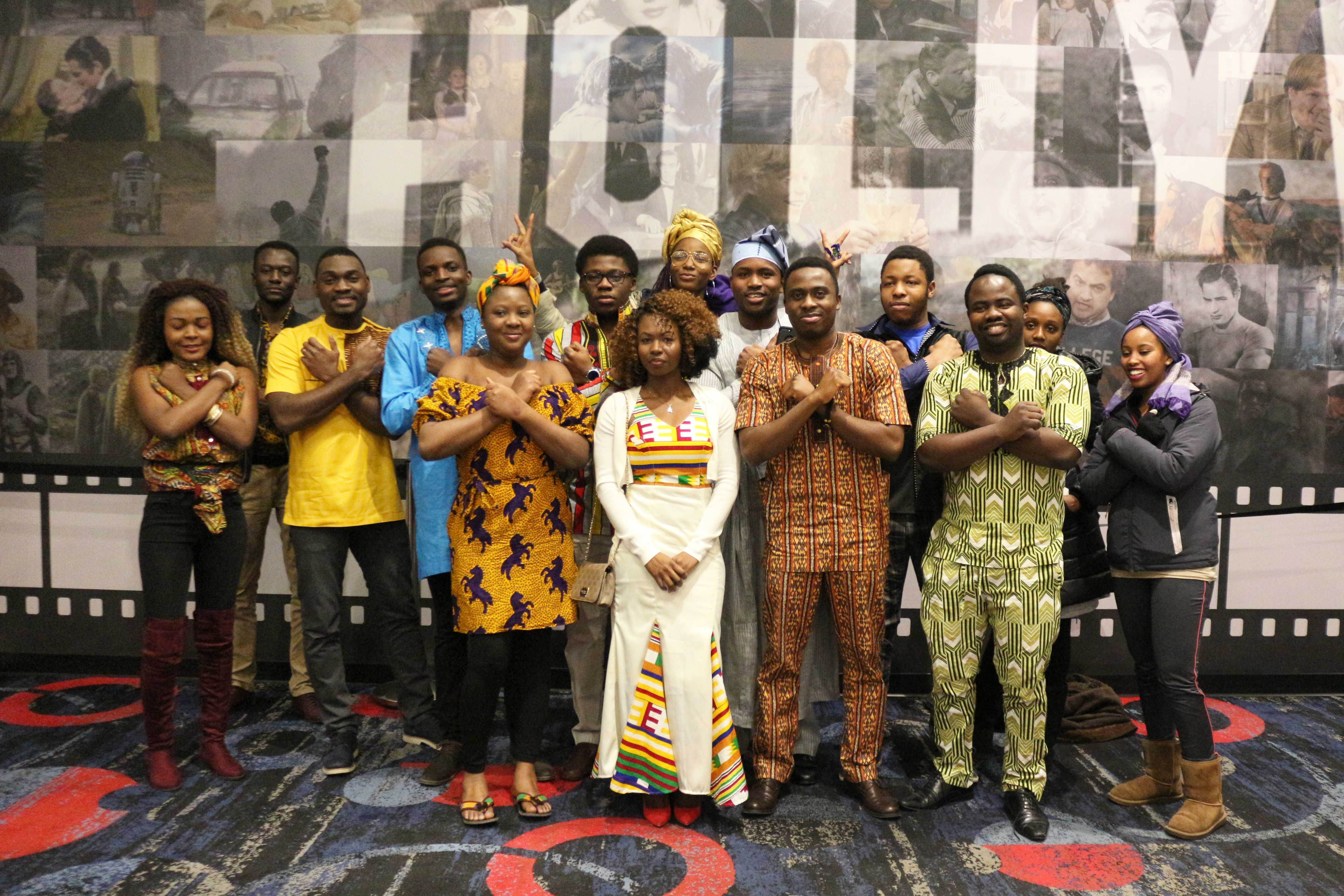 "IAN LACK Members of the ASA pose for photos after the showing of ""Black Panther."" Many were dressed in traditional African clothing from their respective native countries."