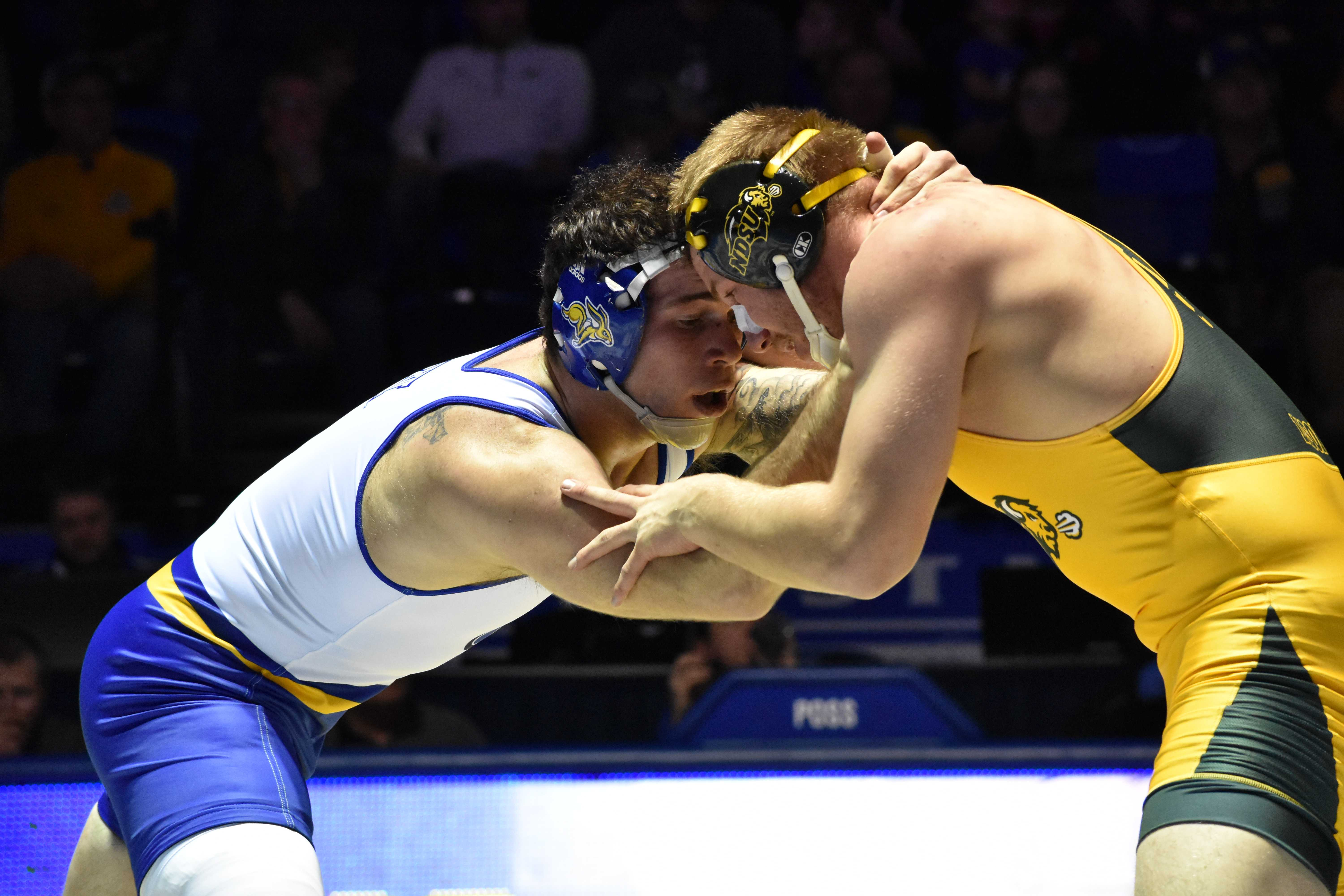 ABBY FULLENKAMP Senior Nate Rotert wrestles against NDSU Cordell Eaton during the 197-pound bout Feb. 16. Rotert defeated Eaton with a decision of 3-1. SDSU is sending seven wrestlers to the NCAA Championships in Cleveland, Ohio.