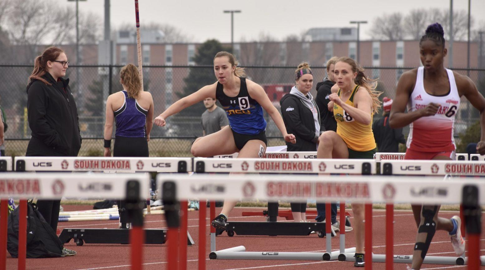 ABBY FULLENKAMP Sophomore Haley Mottinger competes in the women's 100 meter hurdles during the SD Invitational meet April 11 at USD. Mottinger placed 10th with a time of 15.54.