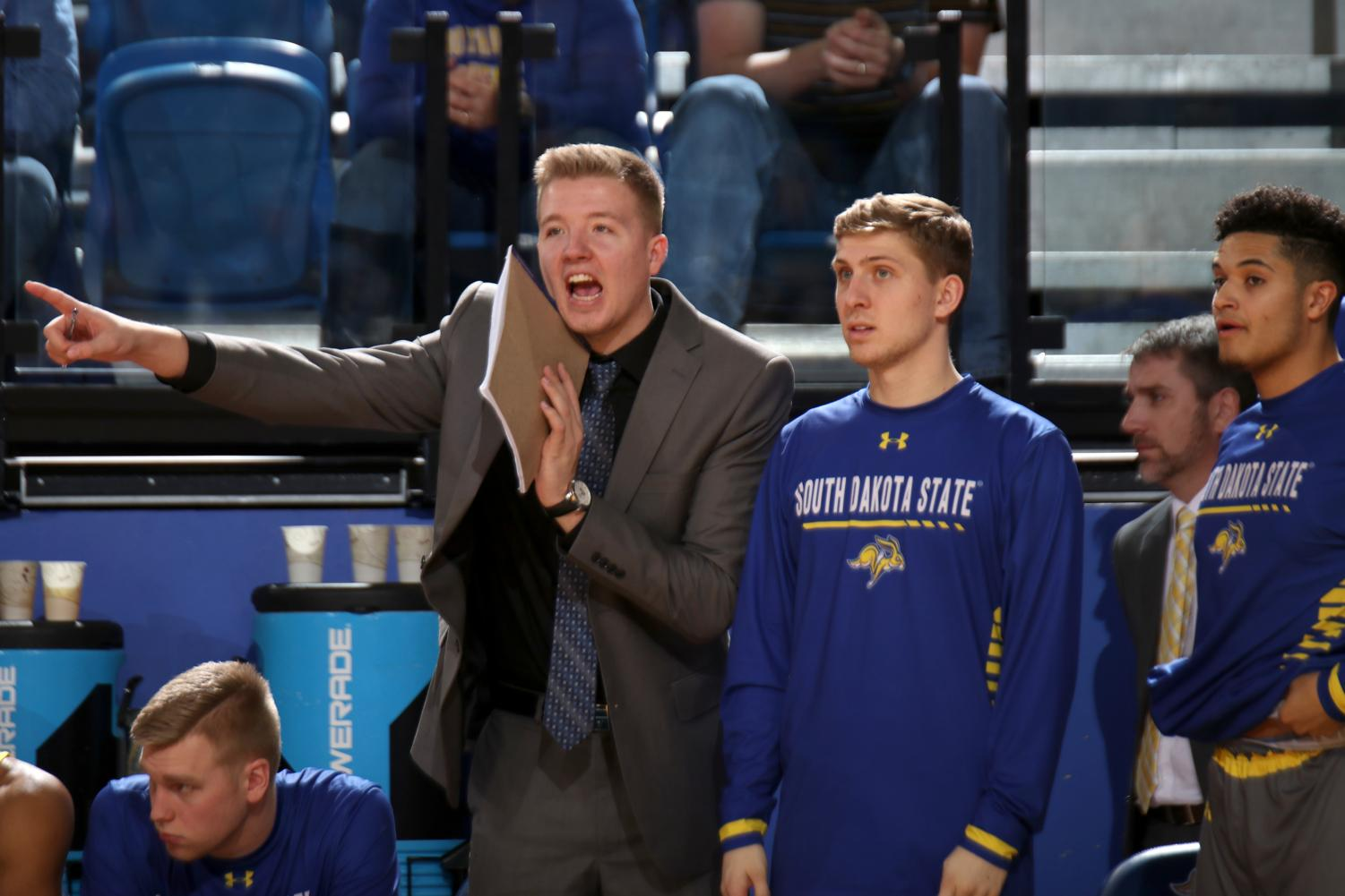 Graduate assistant coach Reed Tellinghuisen yells to the players on the court next to Beau Brown during the SDSU vs. Denver men's basketball game Thursday, Jan. 10 at Frost Arena in Brookings, S.D.