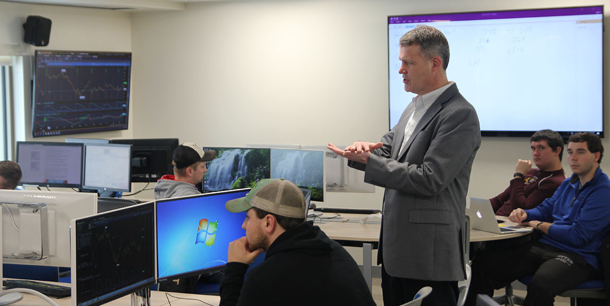 South Dakota State University Professor Matthew Diersen speaks to the agricultural futures and options class in Harding Hall. Thanks to the POET Commodity Trading Fund, the class's 18 students get a real-world, hands-on trading experience.