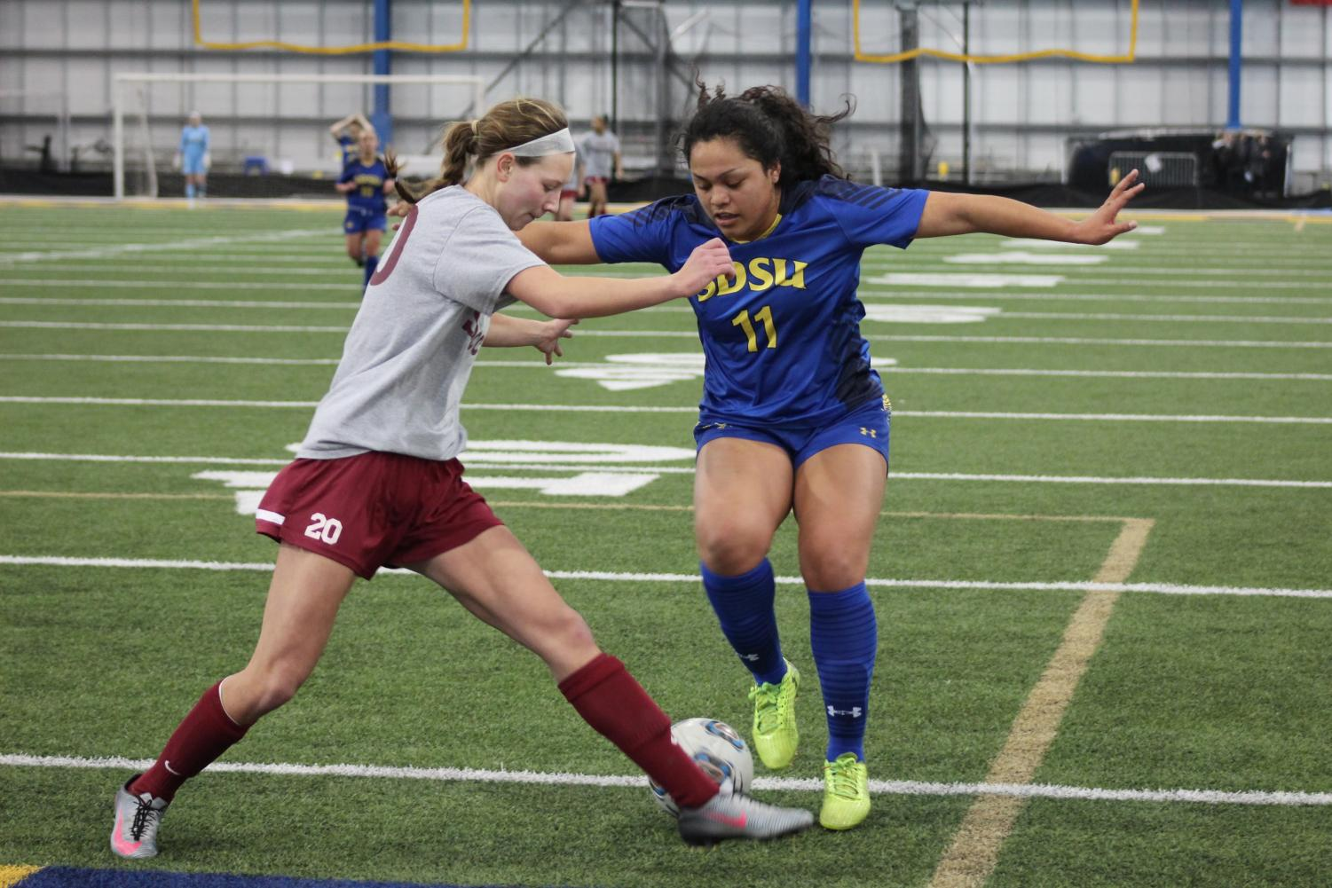 Senior forward Leah Manuleleua (11) dribbles past a defender in the Sanford Jackrabbit Athletic Complex. Manuleleua scored her first two goals of the season against Idaho State Sunday, Aug. 25, at Fishback Soccer Park.