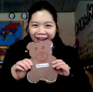 teacher shows brown bear cut out