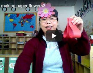teacher shows paper flower pedals
